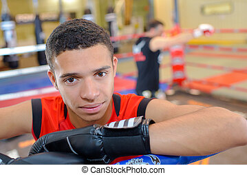Portrait of young man wearing boxing gloves