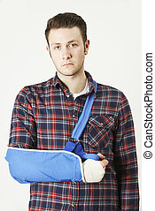 Portrait Of Young Man With Arm In Sling