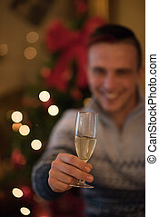 young man with champagne glass on party