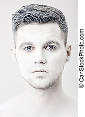 portrait of young man with white face paint. Professional...