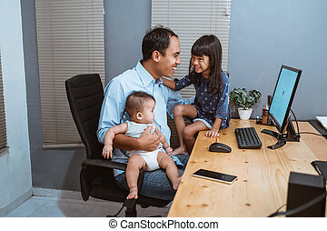portrait of young man work from home playing with his daughter