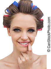Portrait of young model with hair curlers