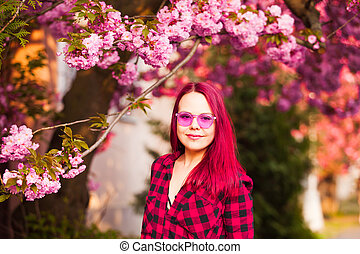 Portrait of young model with sakura bloom