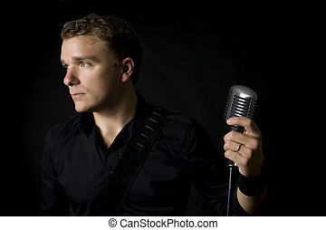 musician - portrait of young musician holding his microphone