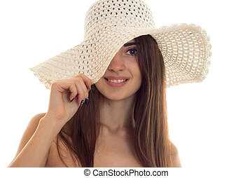 portrait of young pretty brown hair woman in straw hat with wide brime looking and smiling on camera isolated on white background
