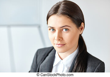 Portrait of young pretty business woman in the office