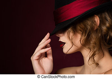 76af9f8fb8a Beautiful young woman with red lips wearing summer black hat with ...