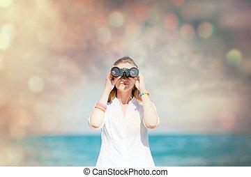 young redhead girl with binoculars