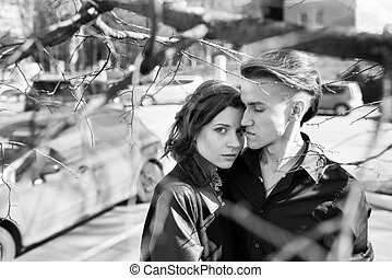 portrait of young sensual couple in the street