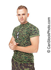young serious army soldier with military ID tags