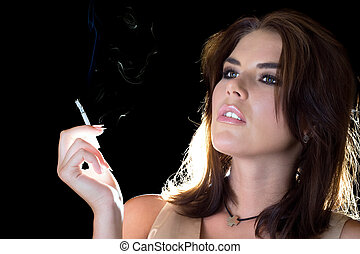 young sexy brunette with cigarette