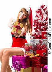 Portrait of young, sexy female Santa isolated on white
