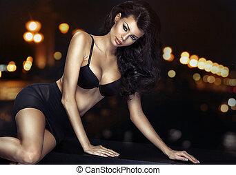 Portrait of young slim brunette woman