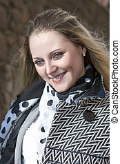 Portrait of Young Smiling Blond Fashionable Female Posing Outdoors.