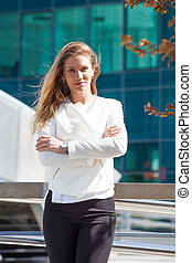 portrait of young smiling business woman outdoor in the city