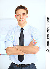 Portrait of young smiling businessman
