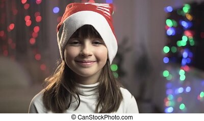 Portrait of Young Smiling Girl in Christmas Hat
