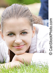 portrait of young smiling girl on nature