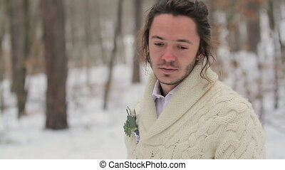 Portrait of Young Smiling Man in Winter Forest