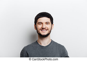 Portrait of young smiling man on white background.