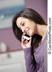 portrait of young smiling woman on phone
