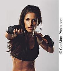 Hispanic female practicing boxing