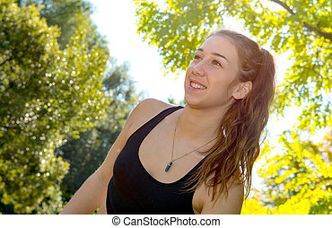 Portrait of young sporty woman, outdoors
