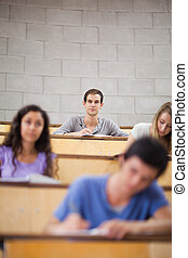 Portrait of young students during a lecture
