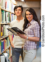 Portrait of young students holding a book