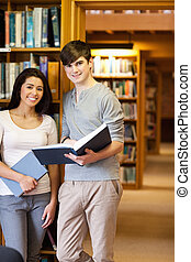 Portrait of young students with a book