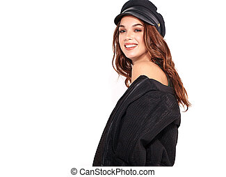 Portrait of young stylish laughing girl model in black casual summer clothes in cap with natural makeup isolated on white background. Looking at camera