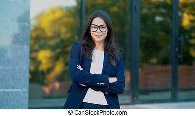 Portrait of young successful businesswoman wearing glasses...