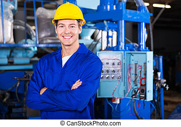 young technician with arms crossed