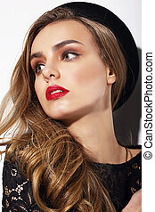 Portrait of Young Trendy Woman in Black Hat