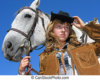 portrait of young unhappy cowgirl with horse