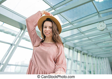 Portrait of young woman an airport lounge waiting for boarding in international airport