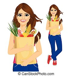 young woman carrying grocery paper bag