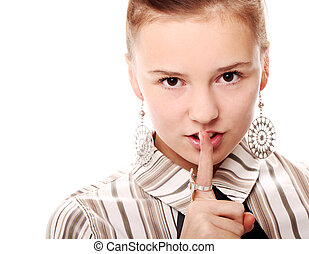 Portrait of young woman doing silence gesture