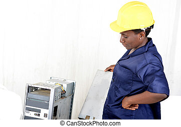 Portrait of young woman doing the maintenance of a desktop computer.