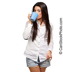 portrait of young woman drinking over white background