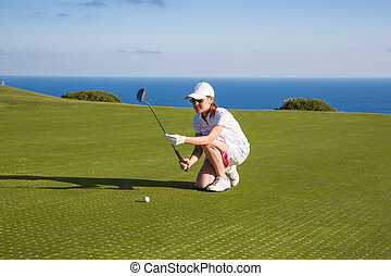 portrait of young woman golfer