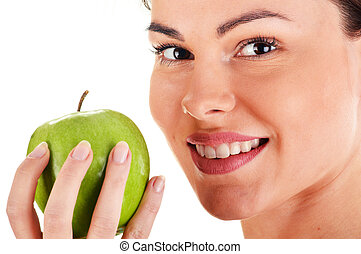 Portrait of young woman holding apple isolated on white