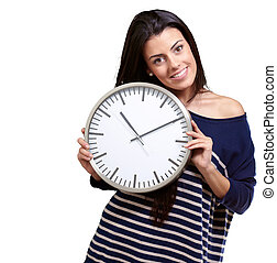 portrait of young woman holding clock against a white background