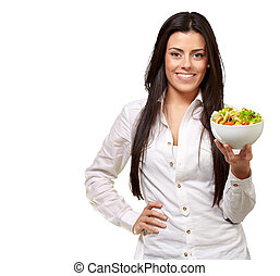 portrait of young woman holding salad over white