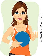 young woman holding table tennis racket and ball
