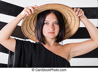 woman in a straw hat