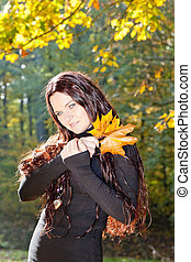 portrait of young woman in autumn