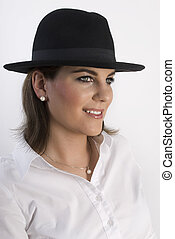 Portrait of young woman in black hat.