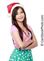 Portrait of young woman in christmas santa hat