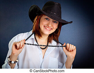 Portrait of young woman in dark cowboy hat